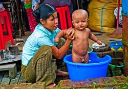 Mother Giving Baby a Bath, Yangon 2008