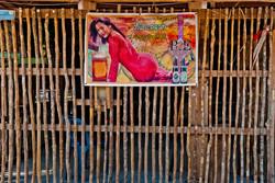 Beer Poster, island village, Beik (Mergui) Archipelago, Myanmar 2008