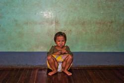 Little Girl Against Wall, Yangon 2009