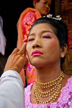 Woman having makeup applied, Shinbyu Ceremony, Inwa (Ava), Myanmar 2007