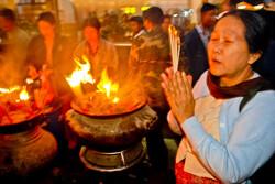 Woman Praying, Kyaiktiyo (Golden Rock), Mon State, Myanmar 2008