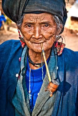 Old Woman Smoking Pipe, near Kyaing Taung, Myanmar 2008