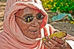 Old Woman Smoking a Cheroot, Mingun, Myanmar 2007
