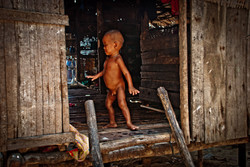 Boy in Doorway, Salone Village, Myeik Archipelago, Myanmar 2008