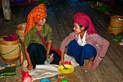 Two Young Pao Girls Eating, Inle Lake, Myanmar 2008
