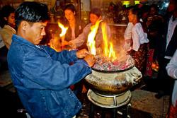 Lighting Incense, Kyaiktiyo (Golden Rock), Mon State, Myanmar 2008
