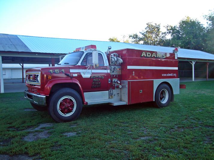ADAMS TANKER 1-5-1, 1987 Chevrolet 350 GPM Pump 1,500 UPF Poly Tank