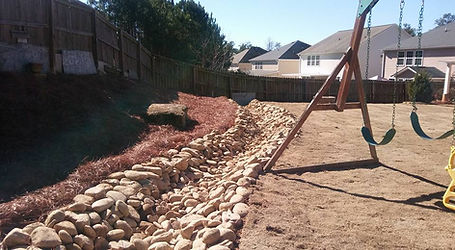 We specialize in dry creek beds and other irrigation problems