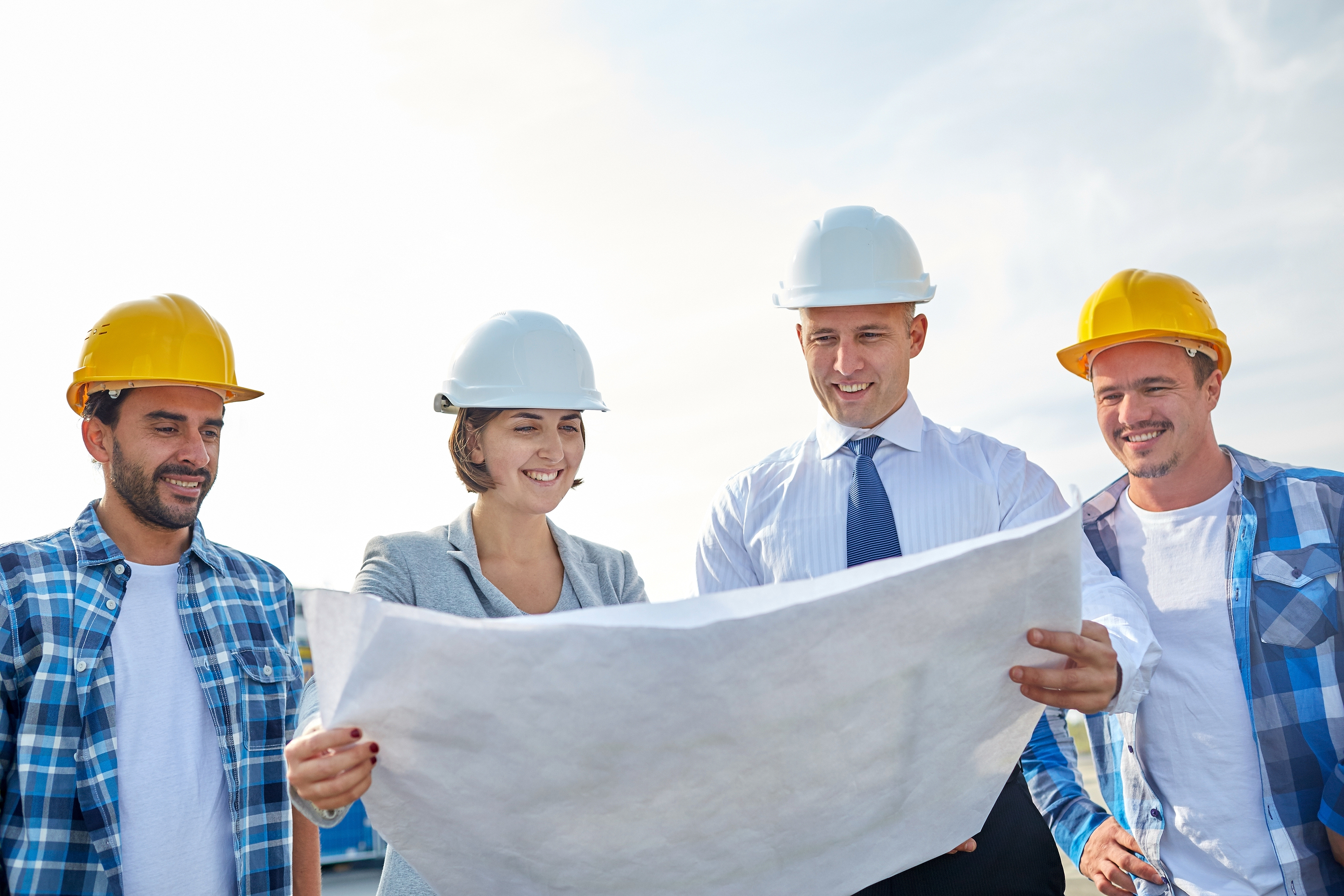 business, building, teamwork and people concept - group of builders and architects in hardhats with