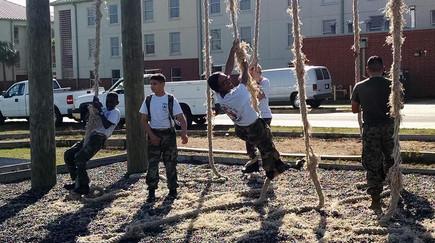 Young Marines climbing ropes