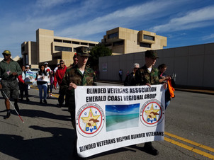 Young Marines of Pensacola assisting Blind Veterans in Veterans Day Parade
