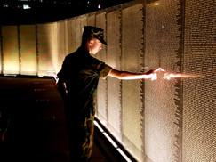 Night image of Young Marine at Veterans Memorial Wall