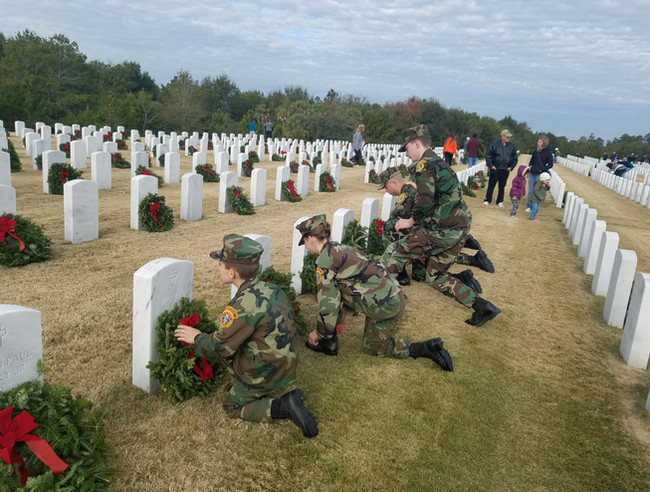 Young Marines laying wreaths for Wreath's Across America