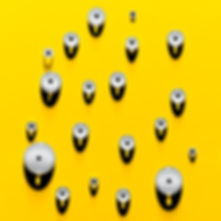 Cosmetic photography of a series of droplets looking like eyes on a yellow background