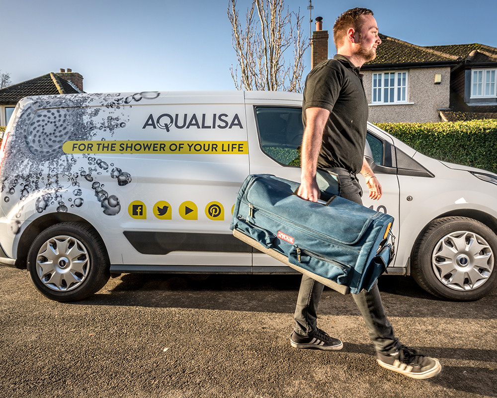 Brand image for Aqualisa showing customer service maintenance man in van shot on location