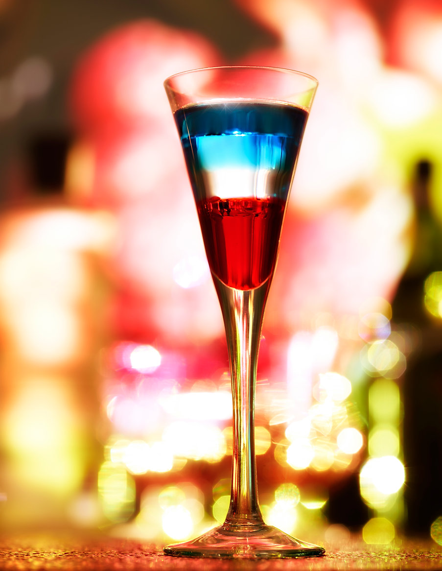 Drink photography of an American Flag cocktail in a bar