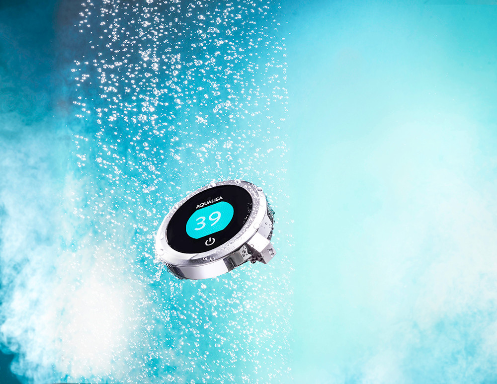 creative product photography of a shower controller in a blue steamy bathroom setting with water shot at RGB Digital Ltd London studio