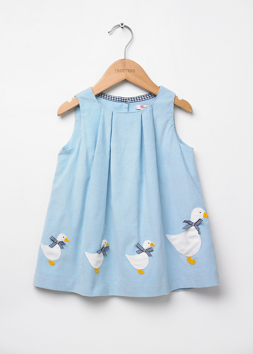 blue children's fashion dress, shot on a hanger at RGB Digital studio's, Acton, West London