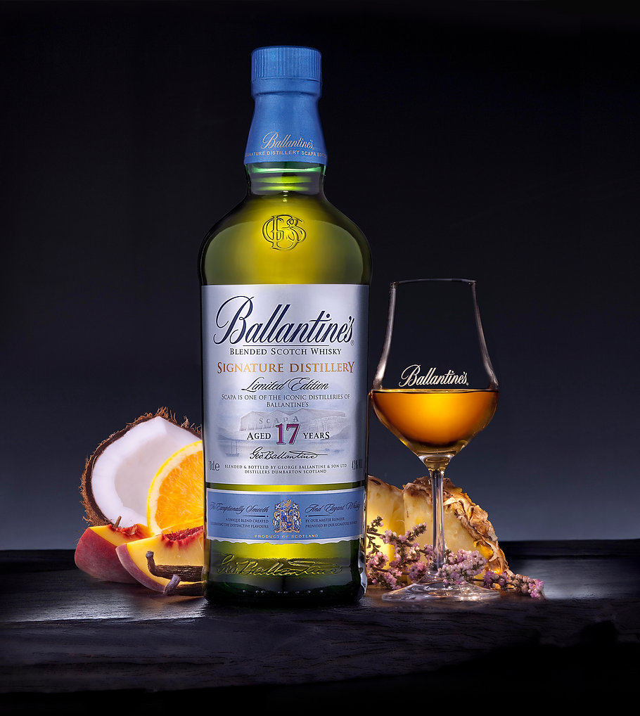 Drink photography of a bottle and glass of Ballantines Scotch Whisky with tasting note ingredients