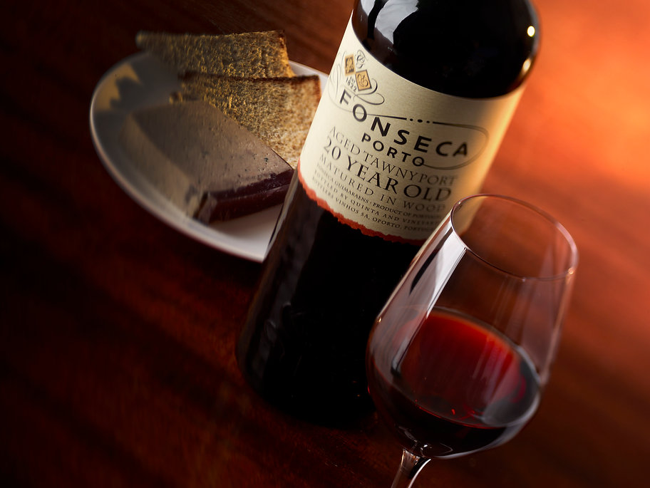 Drink photography of a bottle and glass of 20 year old Fonseca Tawny port with pate and toast