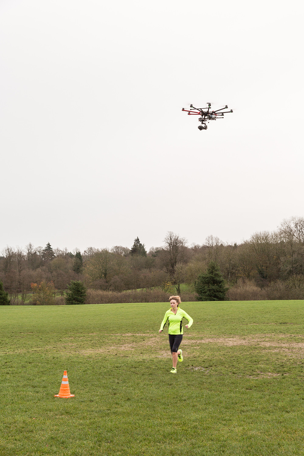 Filming with drone, overhead athletic running shot