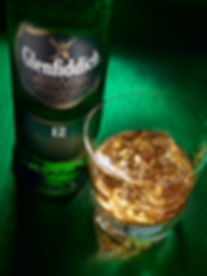 Drink photography of a bottle and glass of Glenfiddich malt whisky with ice