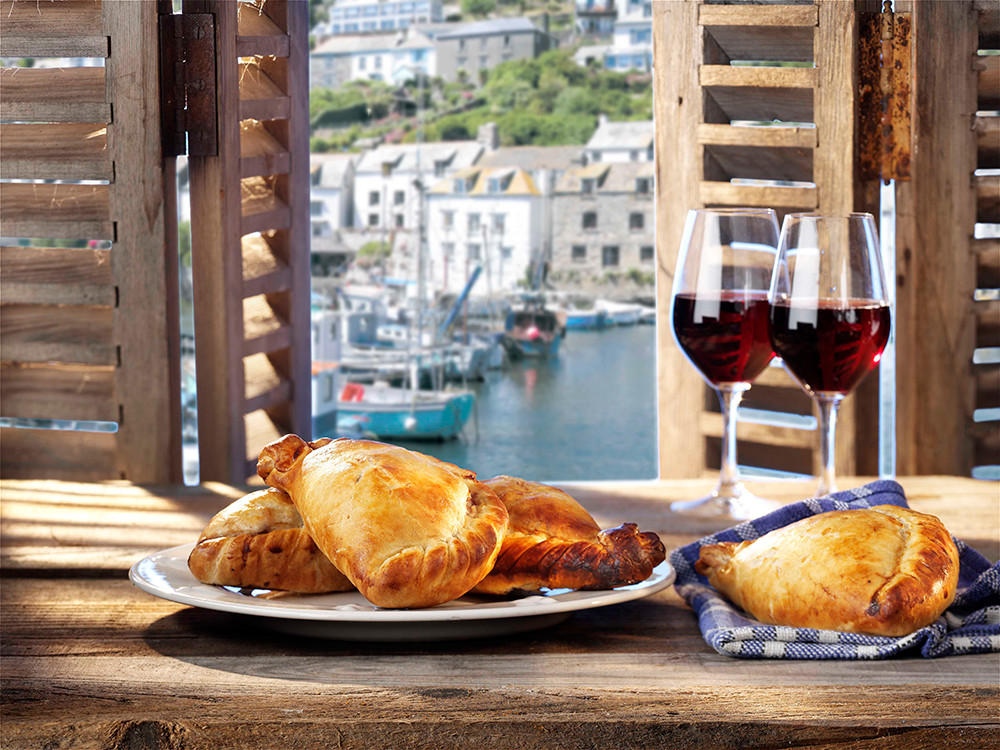 Food photogrpahy cornish pasties and red wine overlooking a dock
