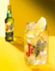 Drink photography of a bottle of J&B Urban Honey whisky and drink