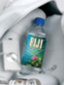 Drink photography of a bottle of Fiji artesian water in a gym bag