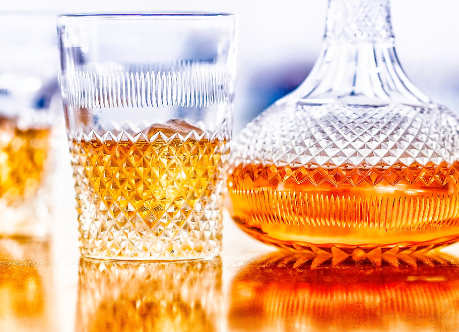 Drink photography of a cut glass decanter and tumbler of whisky