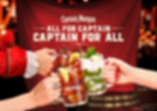 Drink photography of Captain Morgan rum chilled serves doing a cheers with liquid splashing