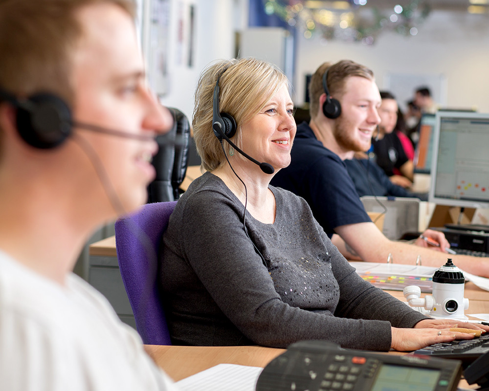 Brand image showing customer service at a call centre. Shot on location by London photographers at RGB Digital