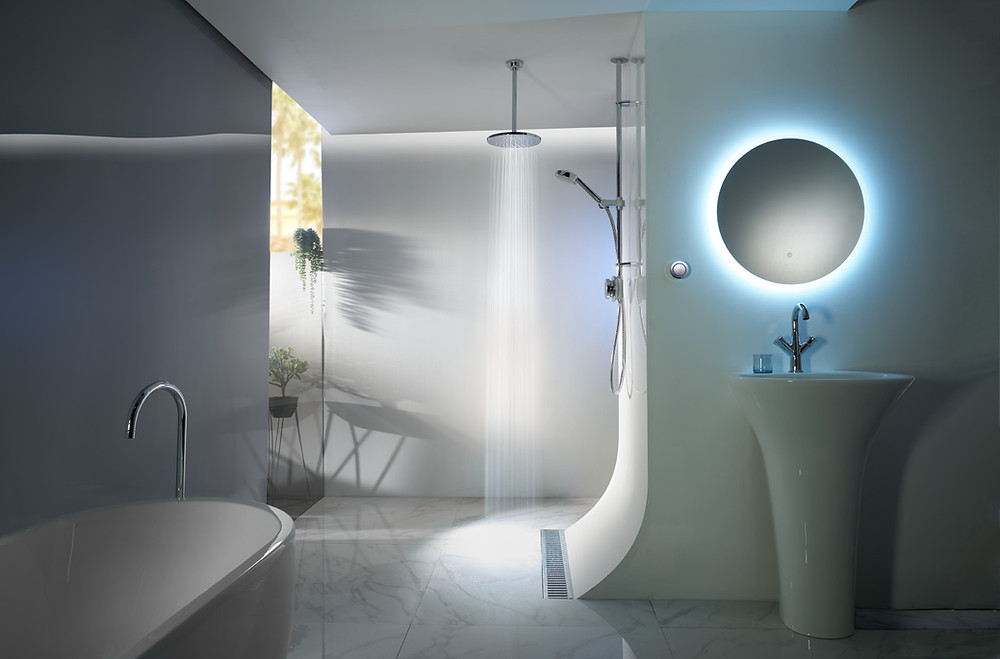 creative product photography of a shower controller in a blue steamy bathroom setting with water shot at RGB Digital Ltd London photography studio
