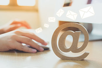 Email marketing concept, Hand using computer sending message with wooden email address sym