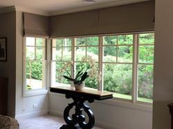 roman blinds in bay window