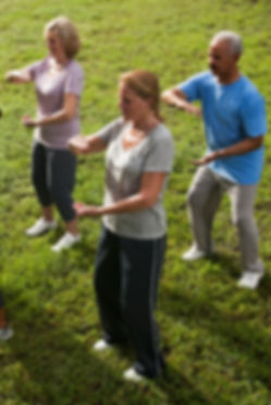 Tai chi class. Male and female students performing at Tranquil Heart Tai Chi in Remuera Auckland