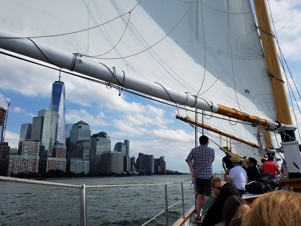 Sails up past Lower Manhattan