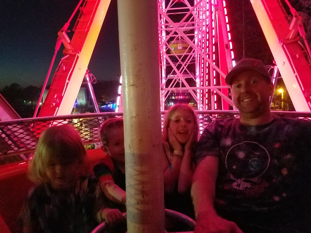Nighttime with the kids on the ferris wheel
