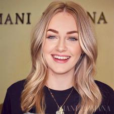 Natural beauty girl smiling after permanent make up tattoo.jpeg