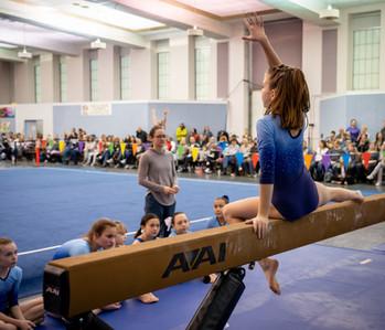 Gymnast Posing on Beam