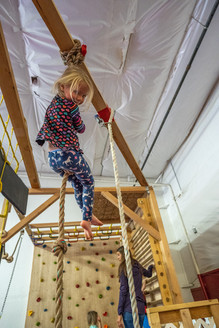 Child at the top of the rope