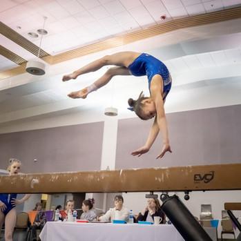 Gymnast Performing on Beam