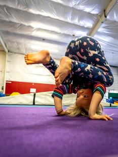 Summer Camp: Child Practicing Handstand