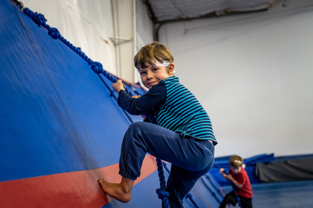 Child Climps up Rope