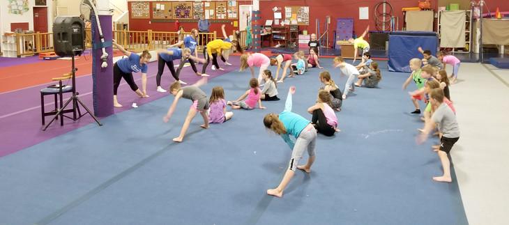 Children warming up on the Gymnastics Floor