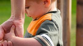 large_holding_hands_kid.jpg