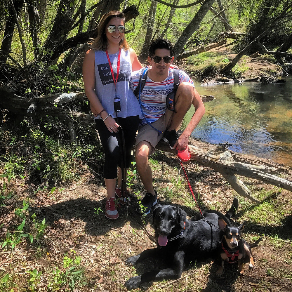 Yvette hiking with her companions, both human and canine