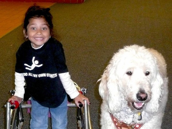 Fry and her service dog.  Photo Courtesy of ACLU.