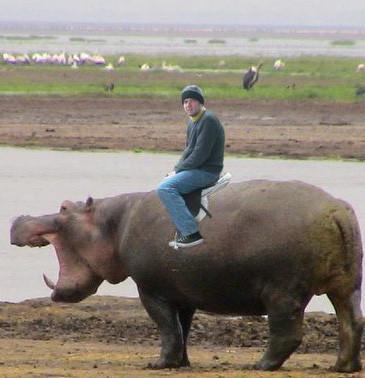 Gregg Morton riding a hippo (obviously real, not photoshopped)