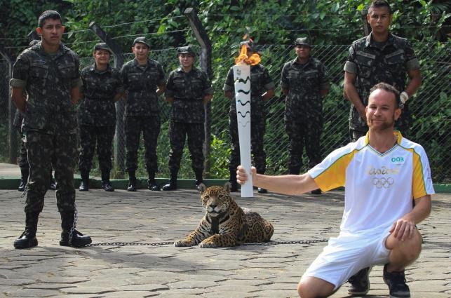 Athlete posing with Juma the jaguar